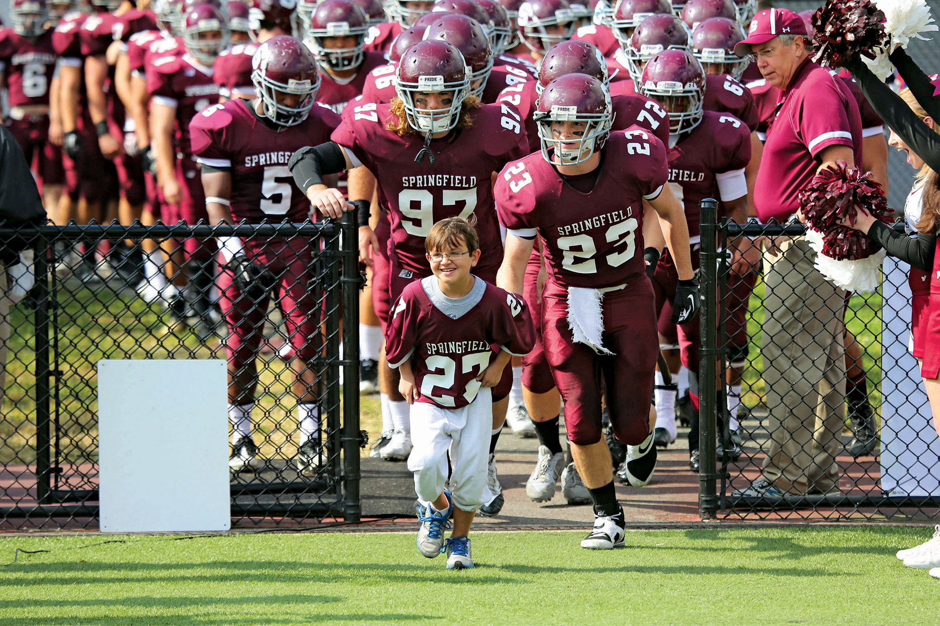 Team Impact participant Luke Bradley and Springfield College Pride football team