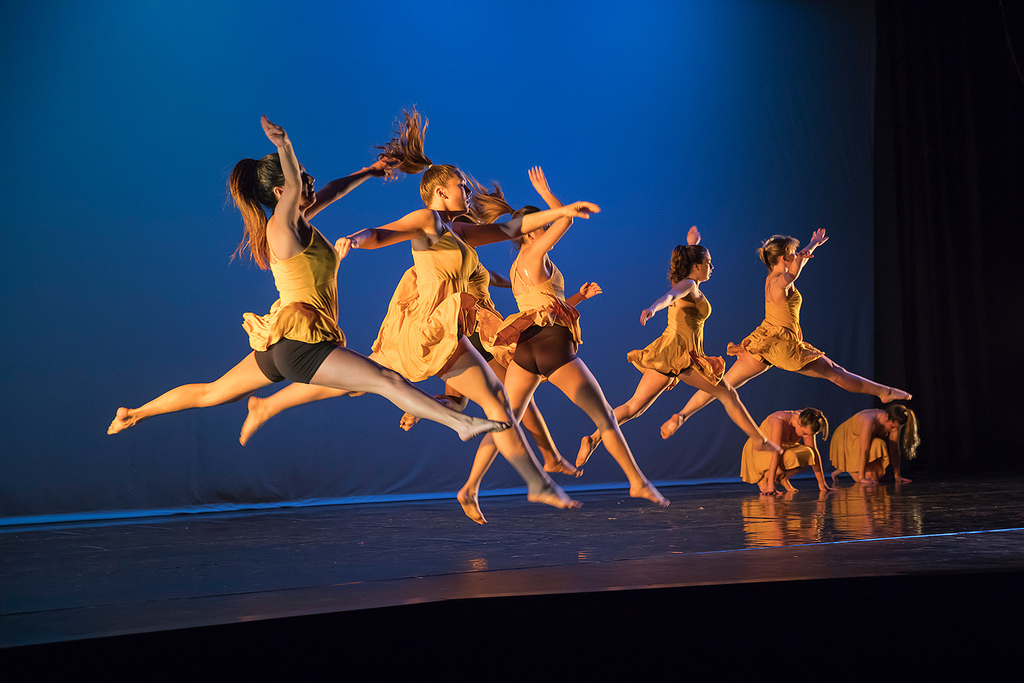 Dancers leap across the stage