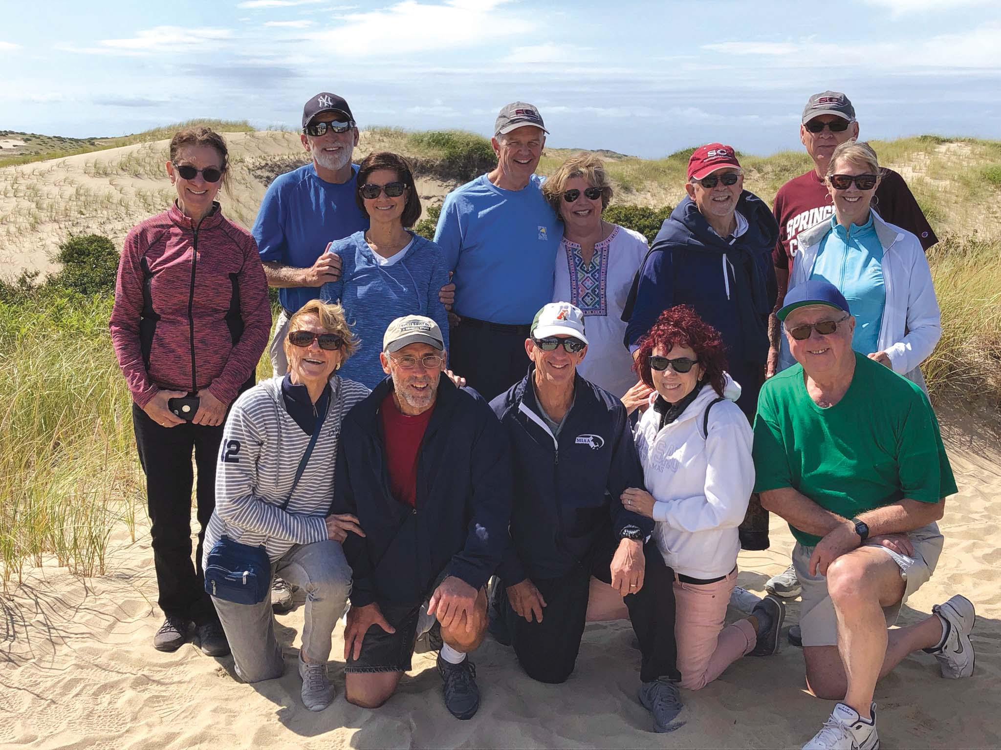 Reuniting Stash members and their wives in Provincetown are, front, from left, Kathy Haff, Jeff 