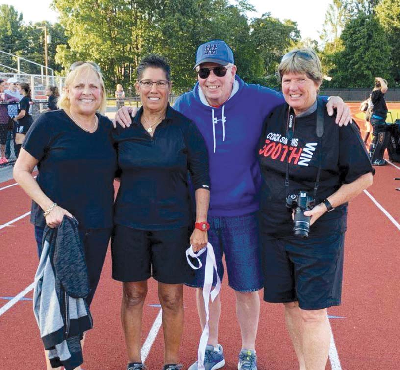 Cathy Meader, G'05, from left, Ann Simons, Deke Pillsbury (Simons' West Springfield High School softball coach), and Springfield College field hockey and softball teammate Beth Gutteridge '81
