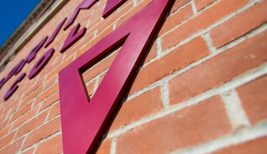 Triangle and logo on the side of Locklin Hall