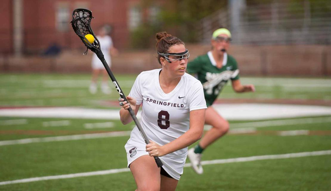 Female Lacrosse Player During a Game at Springfield College