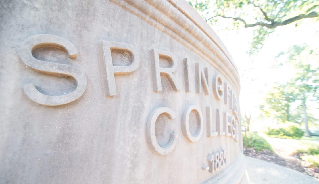 Springfield College sign in stone
