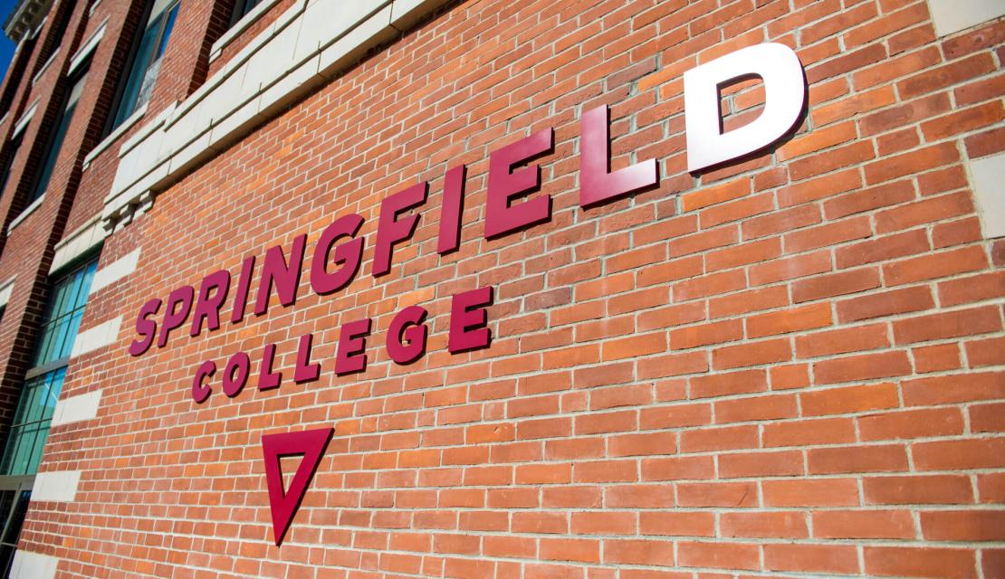 A side view of the Springfield College sign on Locklin Hall