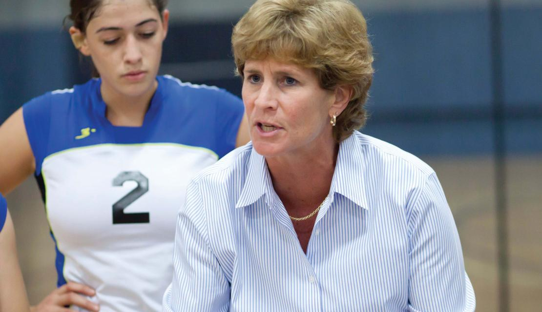Sandra Hoffman coaching volleyball from the sidelines