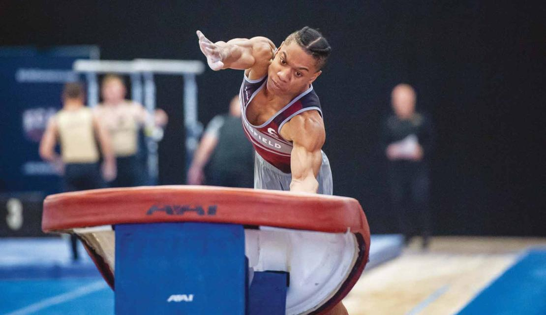 Springfield College gymnast Stephen Lewis on the vault