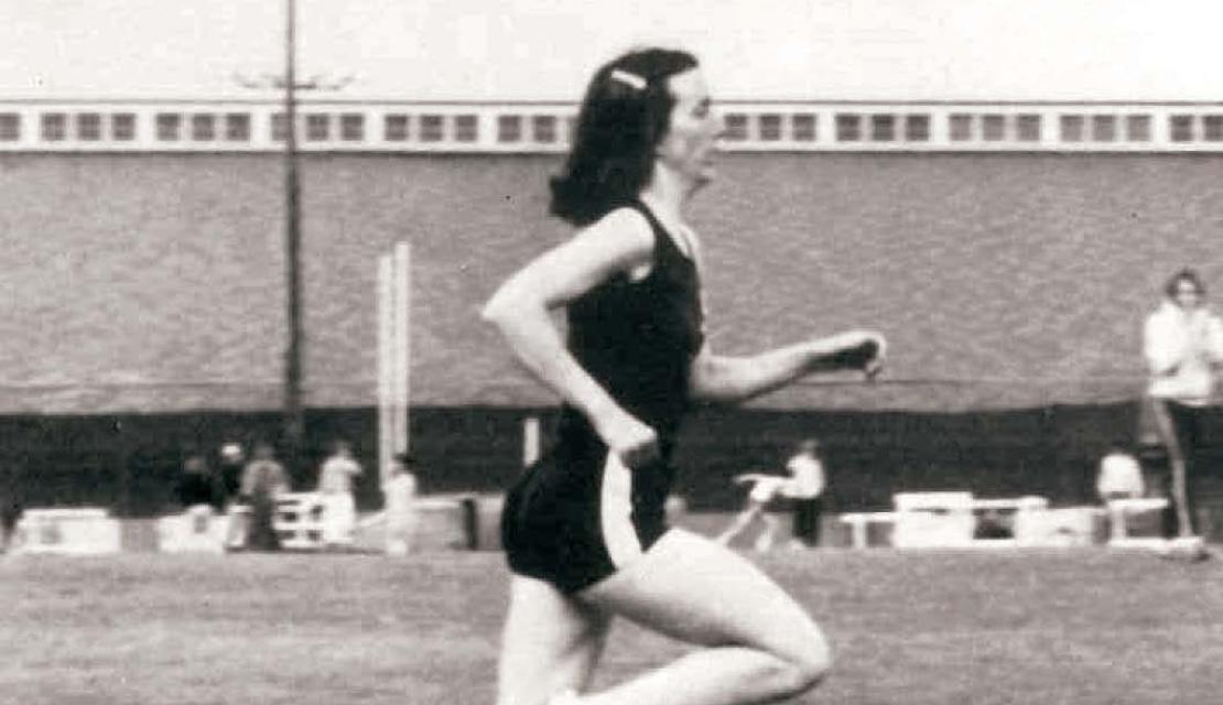 Susan North-Patterson running on the track