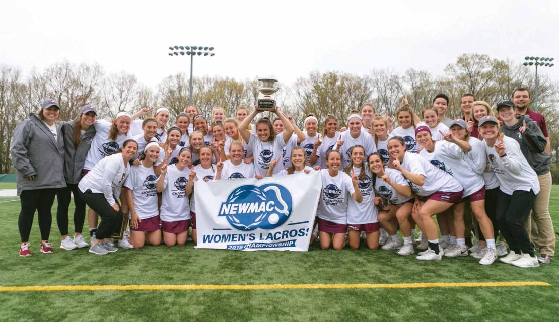 Springfield College women's lacrosse team poses for photo after winning NEWMAC Championship