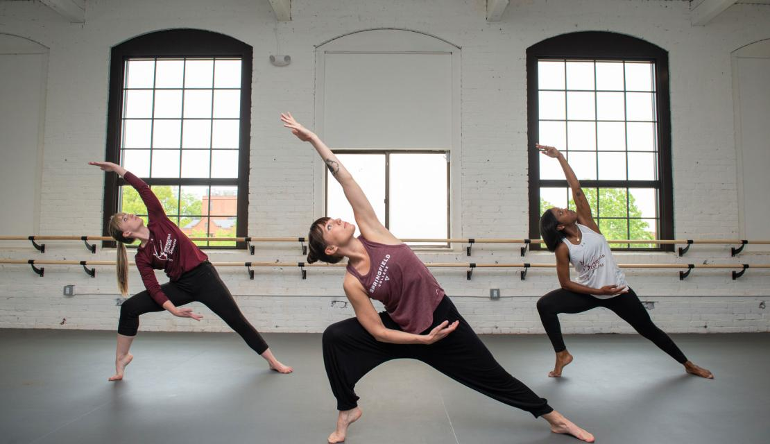 Dancers practice contemporary moves in the Springfield College dance studio