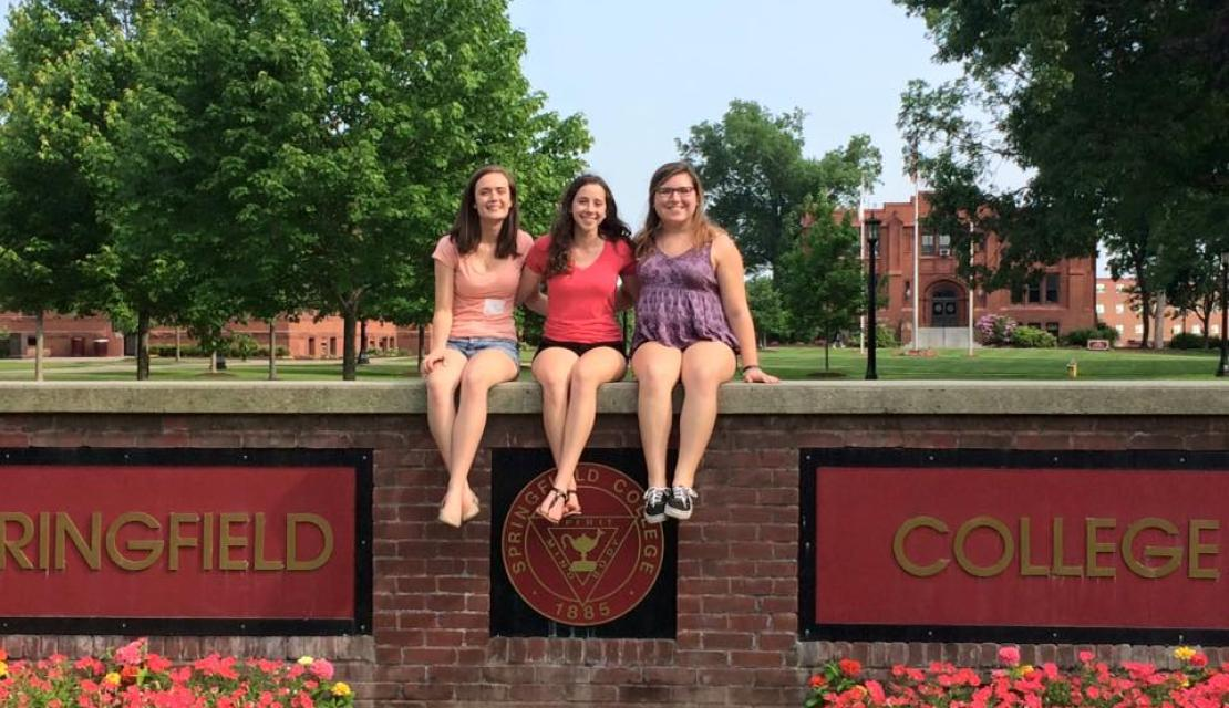 Jess Ashe and friends on the Springfield College sign.