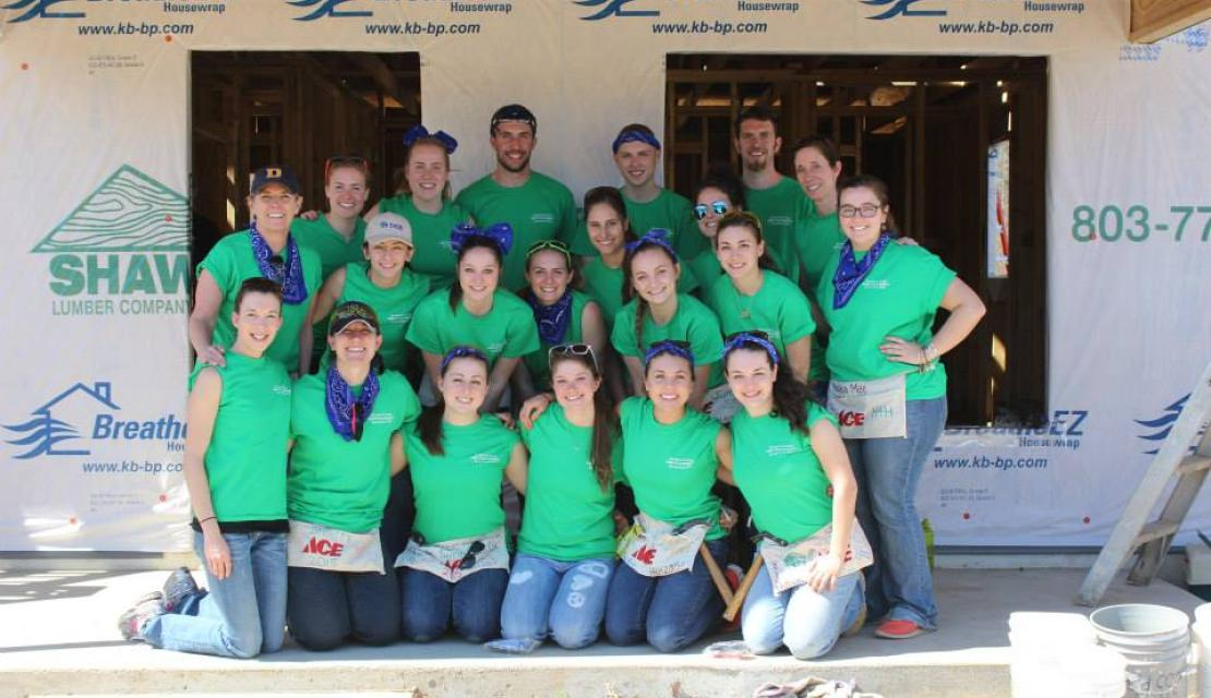 Erin Fitzgerald and group doing habitat for humanity