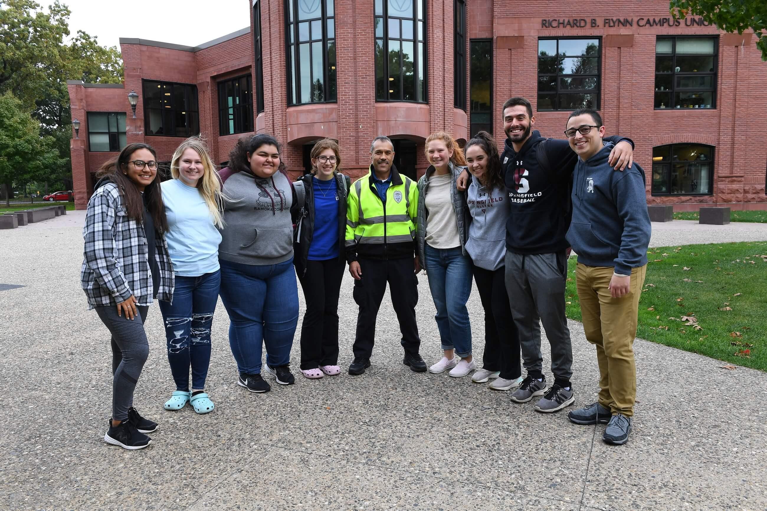 Group of students with a public safety officer