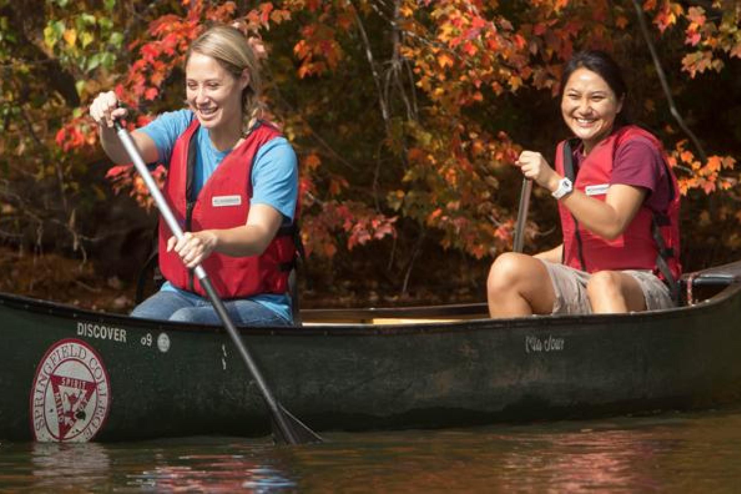 Two female students canoe at east campus