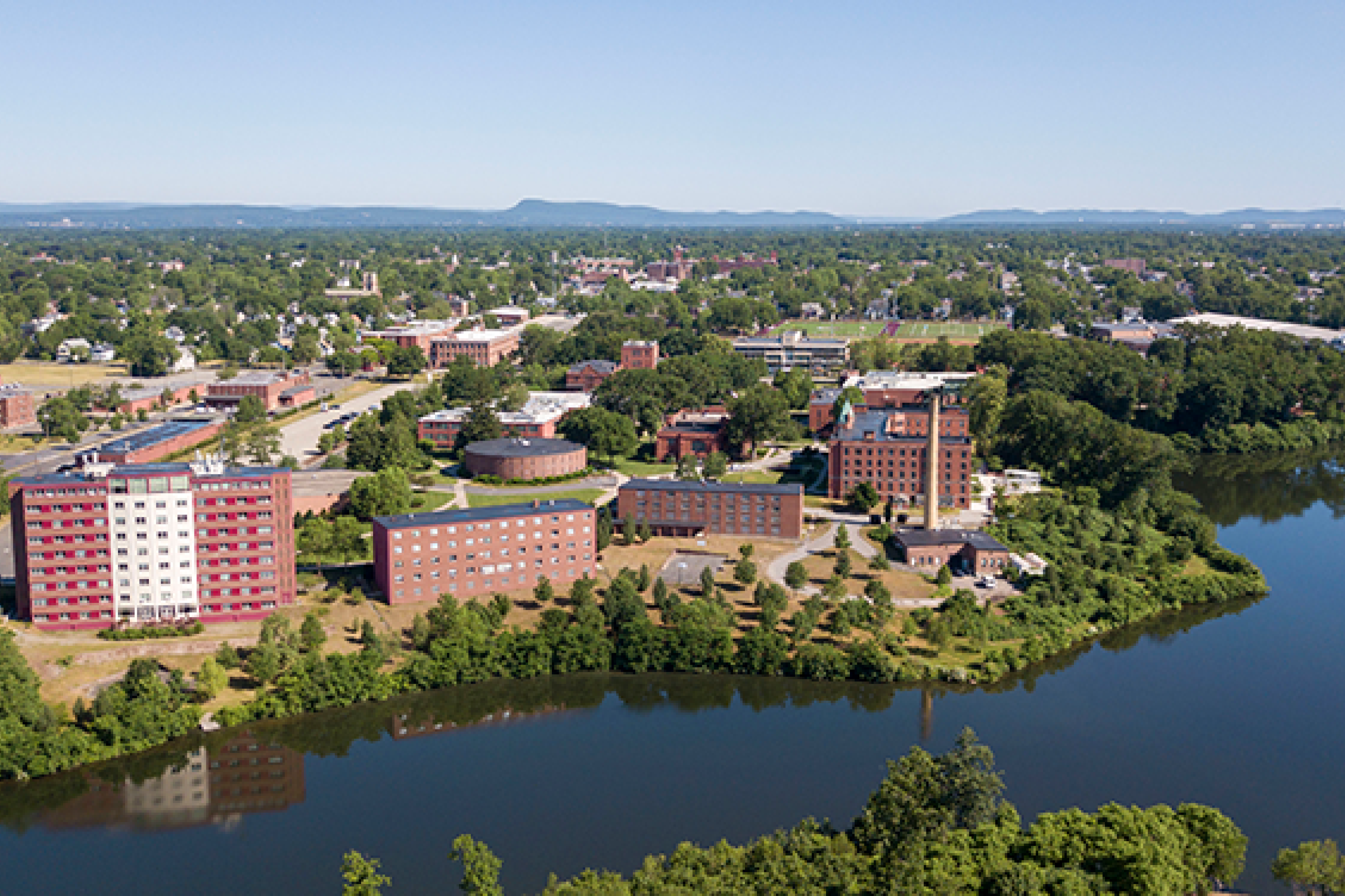 aerial shot of campus by lake