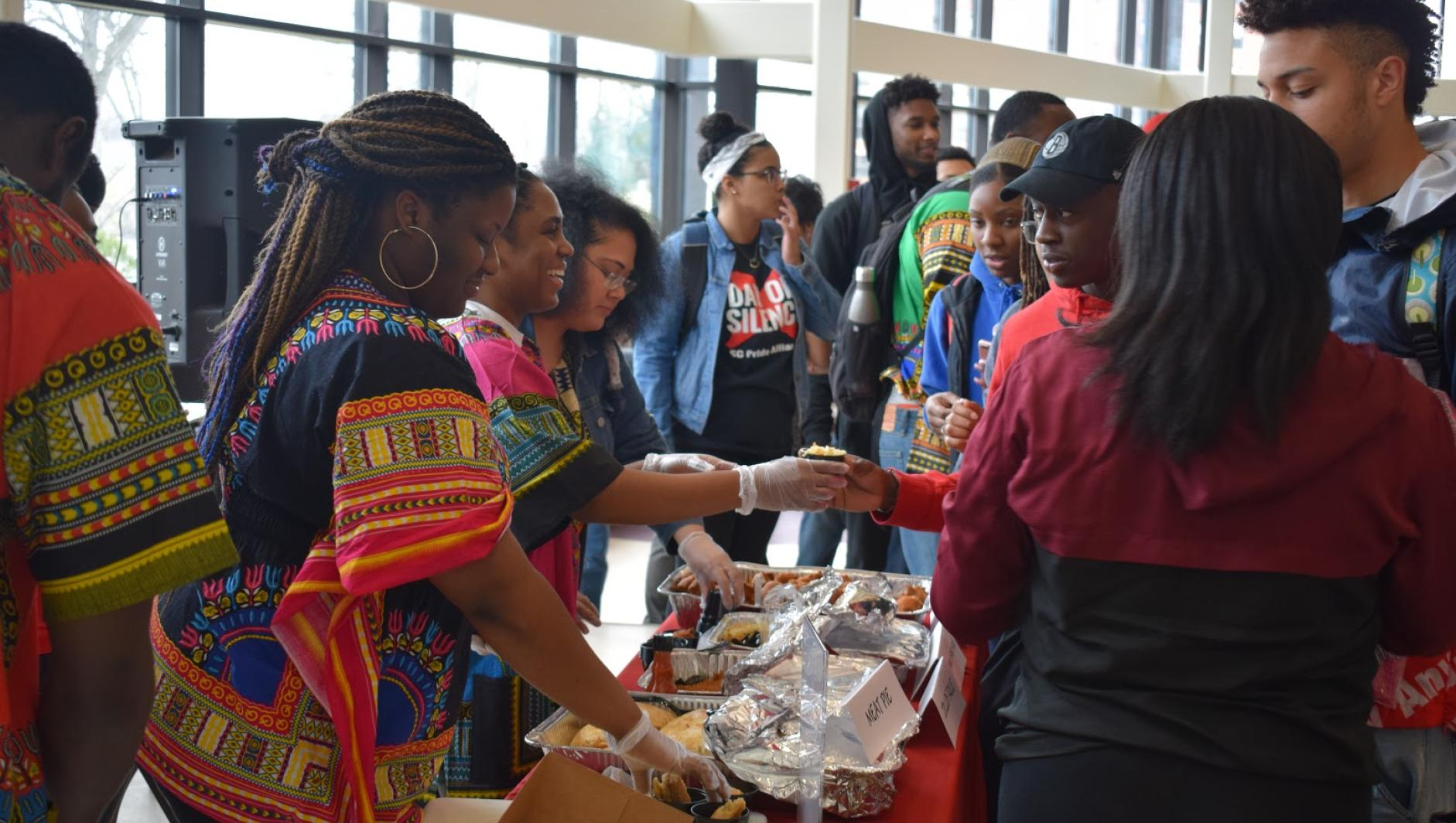 Students serve cuisine during African Cultural Day