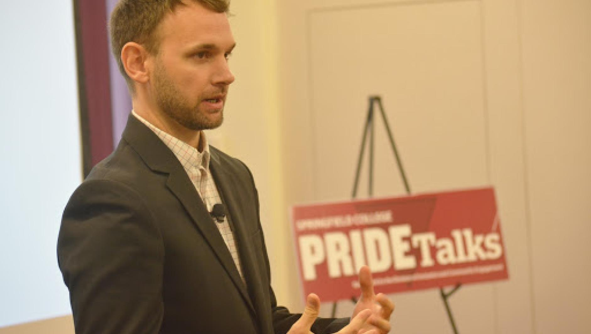 Michael C Cadaret, a professor at Springfield College, lectures during a Pride Talk.
