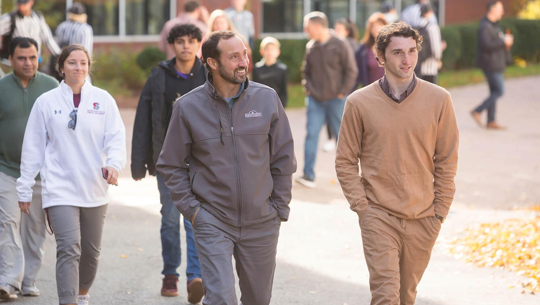 A student and his father walk around campus on Accepted Students Open House day at Springfield College.