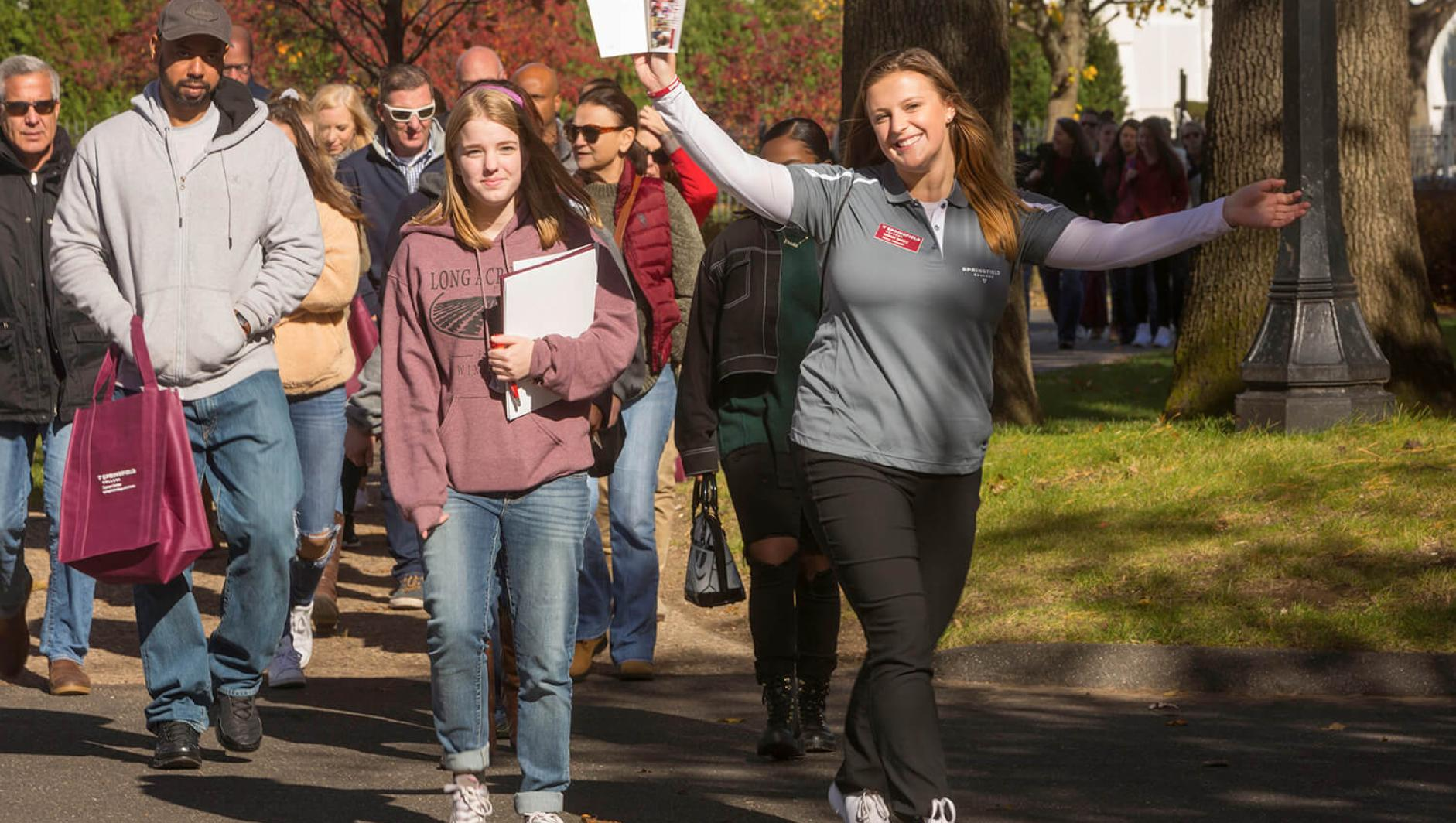 A Springfield College Student Ambassador leads a tour around campus