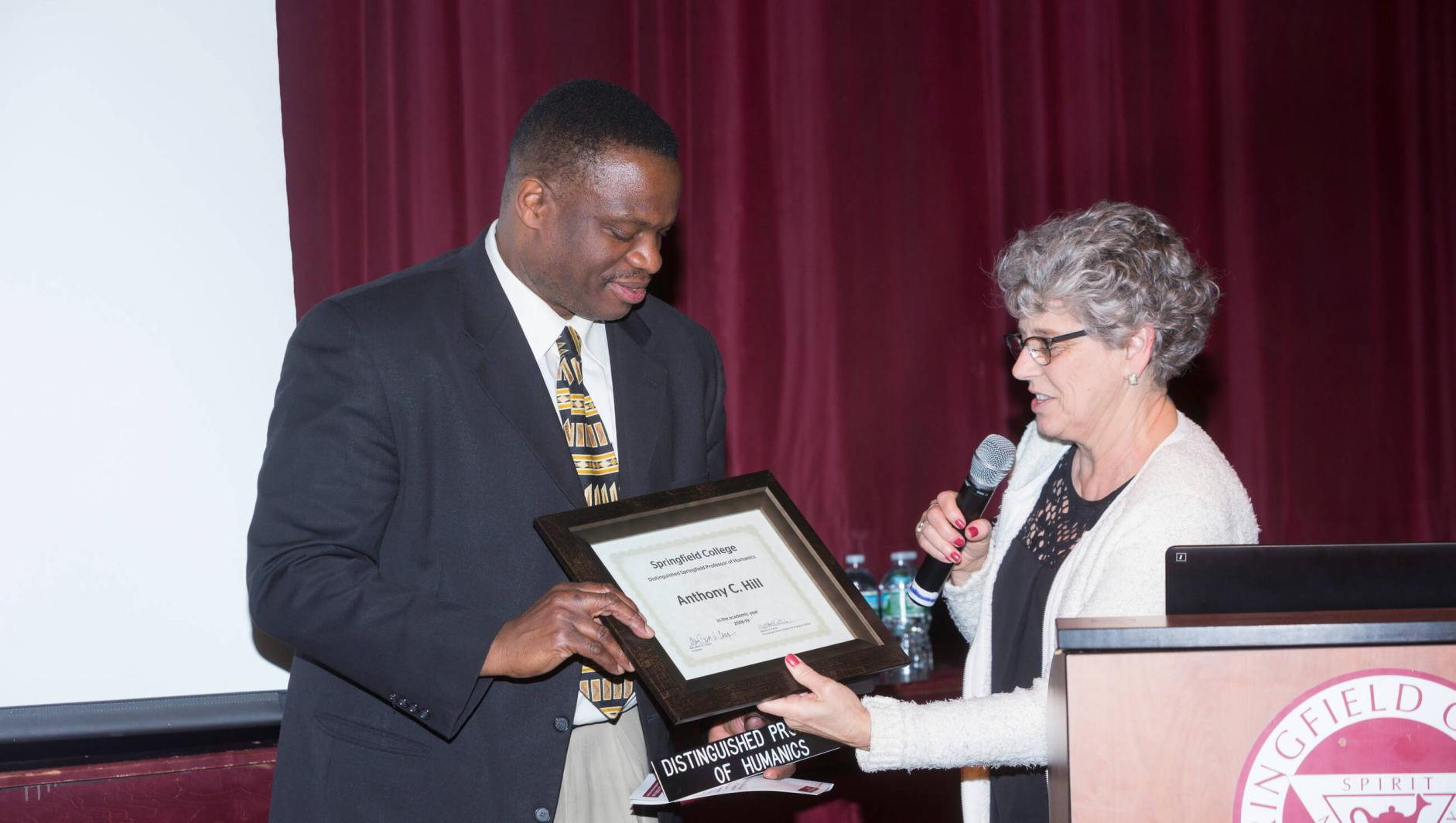 Dr Hill receiving an award.