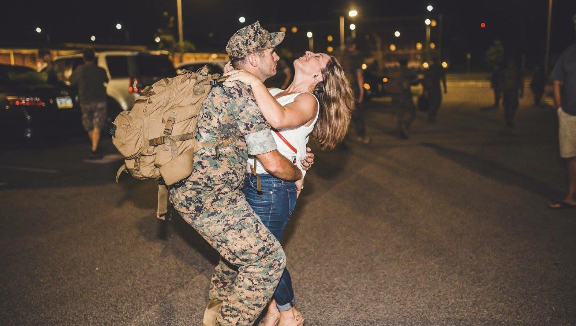 McDonald and her husband greet after a deployment.