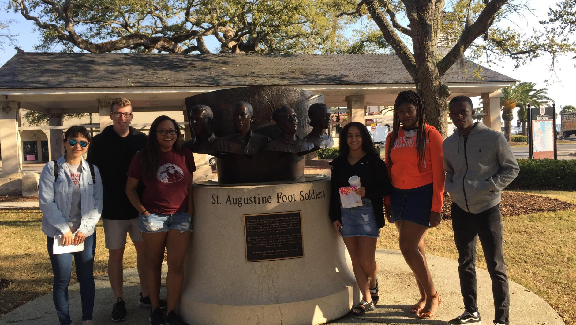 Students posed in front of the Foot Soldiers monument in St. Augustine.
