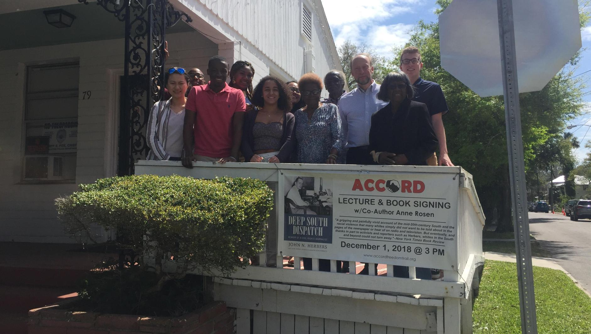 Students pose outside the Accord Civil Rights Museum