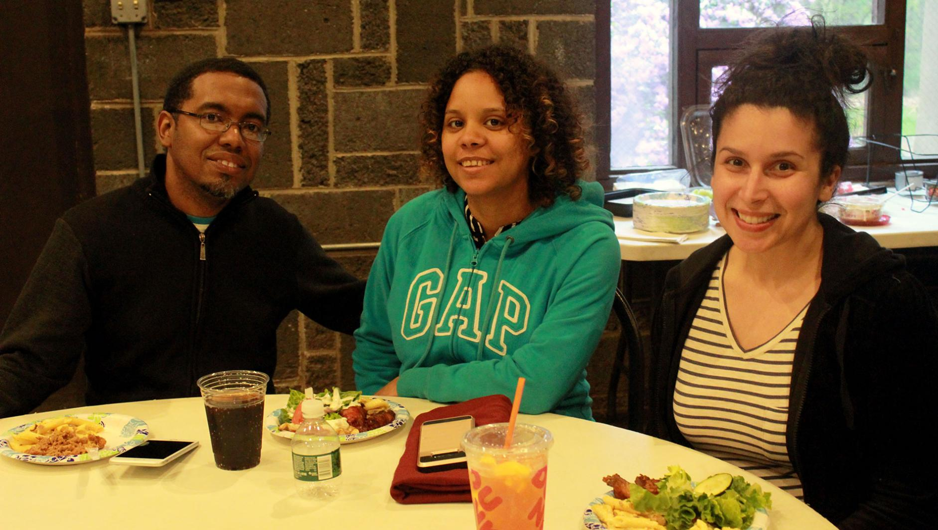 three students at a Graduate Student Organization event
