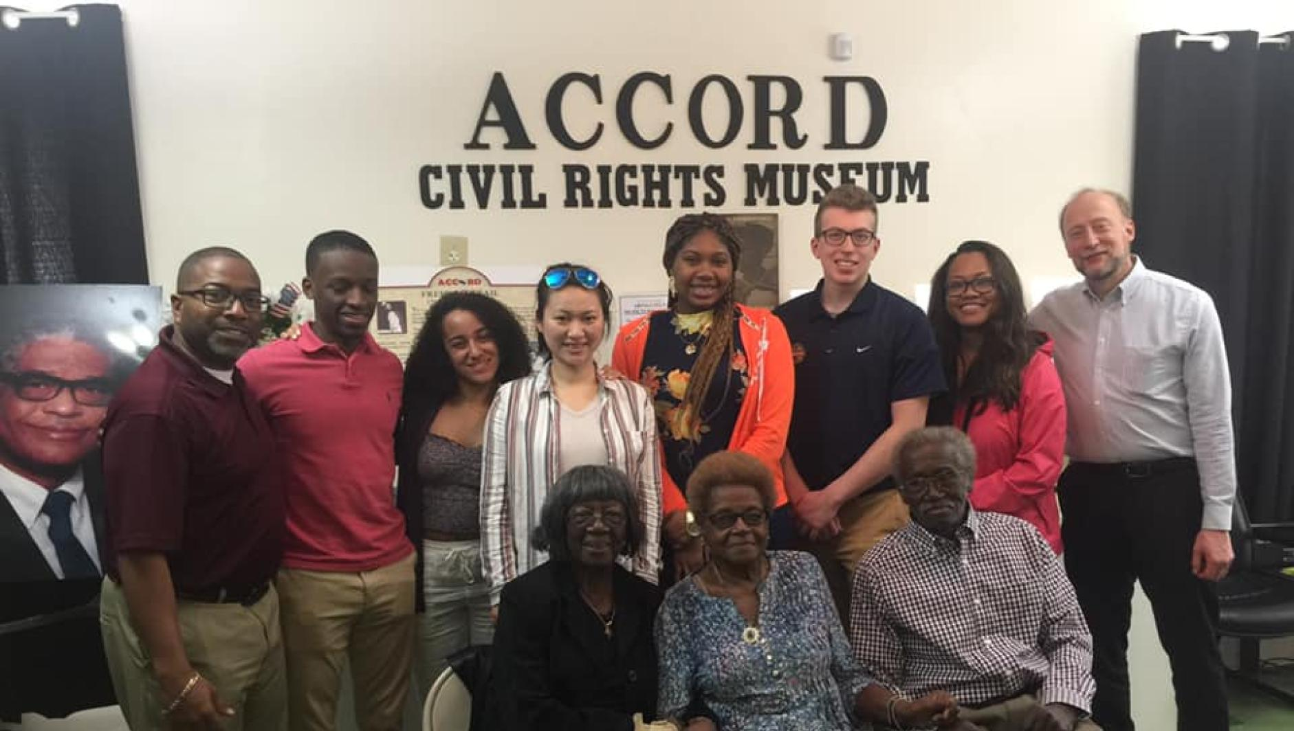 Calvin Hill, Marty Dobrow, and students at the ACCORD Civil Rights Museum.