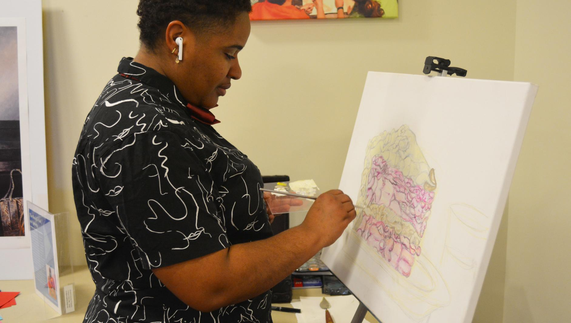 A student works on art at the fourth annual women's tea.