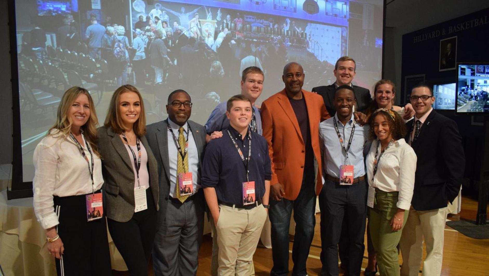 Springfield College students with Sidney Moncrief at the Basketball Hall of Fame.