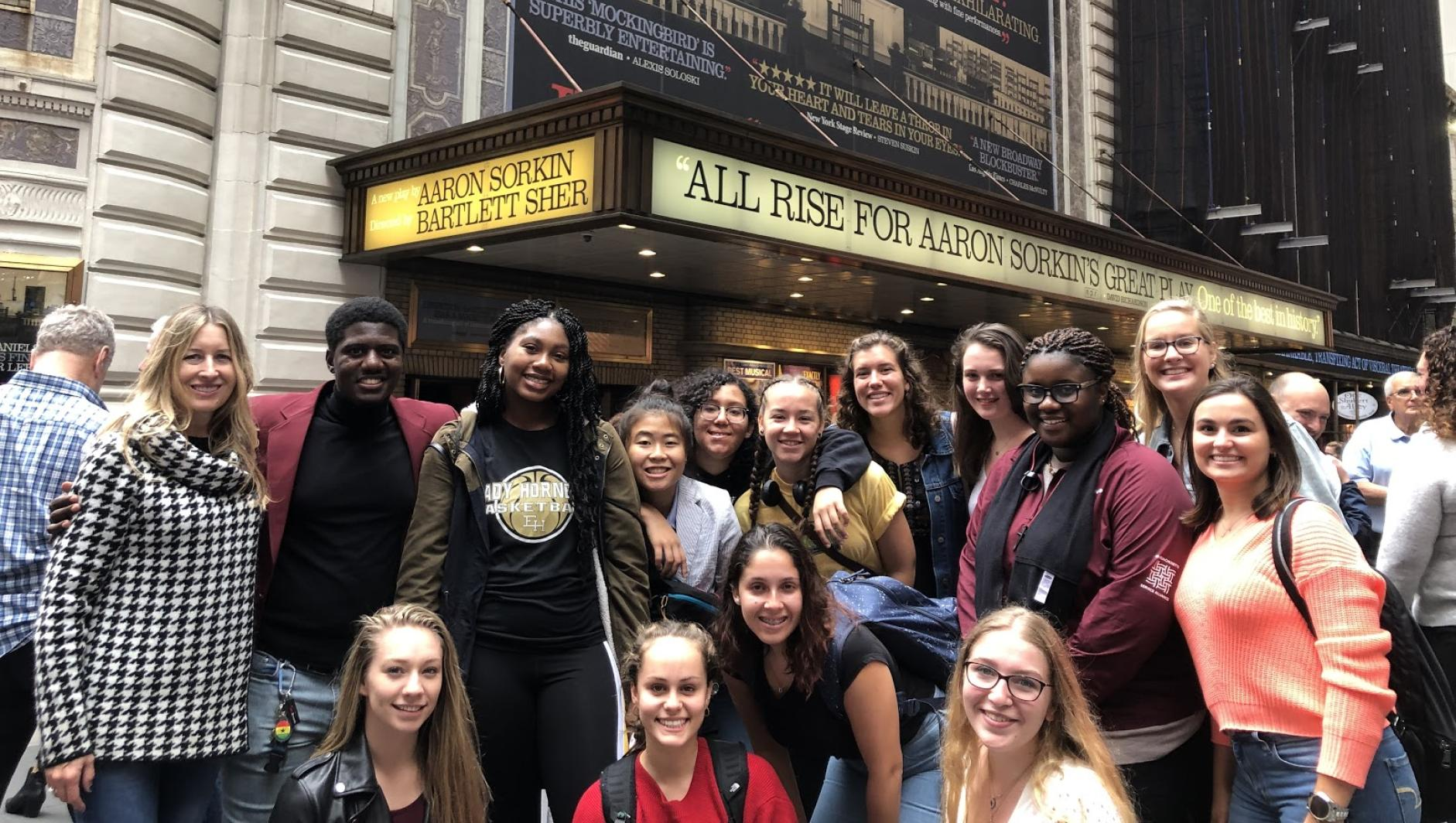 Group of Springfield College students stand outside the theater of To Kill A Mockingbird in NYC