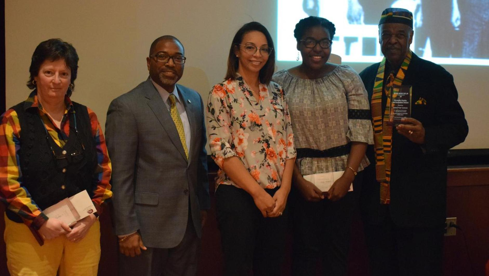 "faculty member Laurel Davis-Delano, student Kathleen Morris, and Springfield community member Mr. Robert ""Cee"" Jackson with Dr. Calvin Hill"