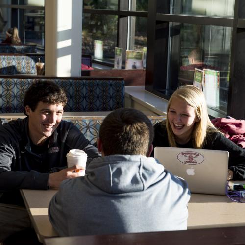 Students hanging out in the Flynn Campus Union