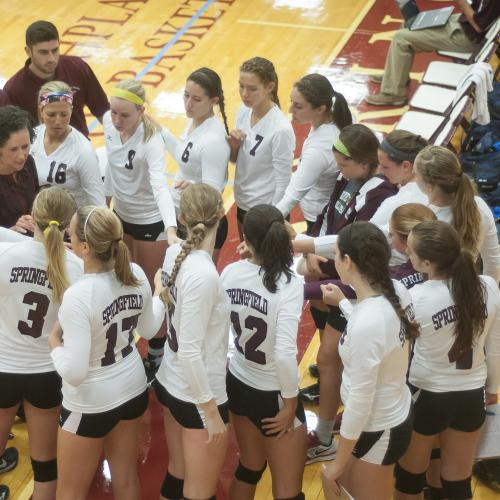 Springfield College women's volleyball team in a huddle