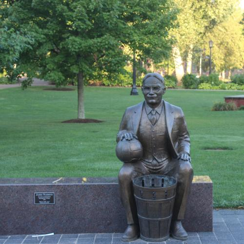 A statue of James Naismith sits on the Springfield College campus
