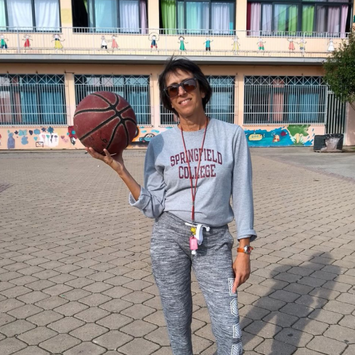 Angela, an alumna from Greece, wears her Springfield College shirt while teaching a course on basketball