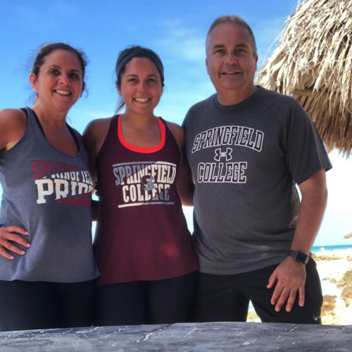 Current student Jessica and her parents sport Springfield College gear while in Aruba.