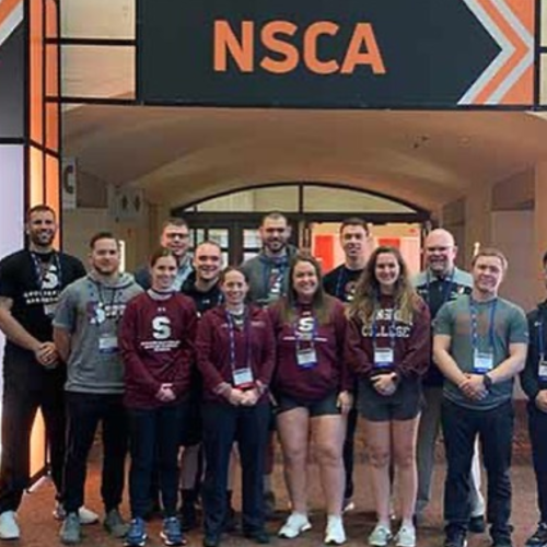 A group of students and faculty at the National Strength and Conditioning Association conference.