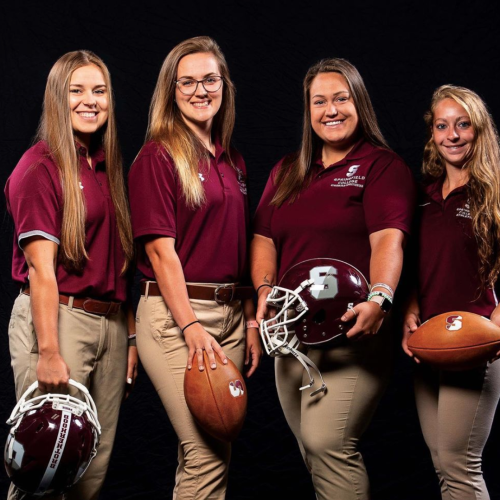 The Triangle cover story featuring the four female strength and conditioning coaches for the football team.