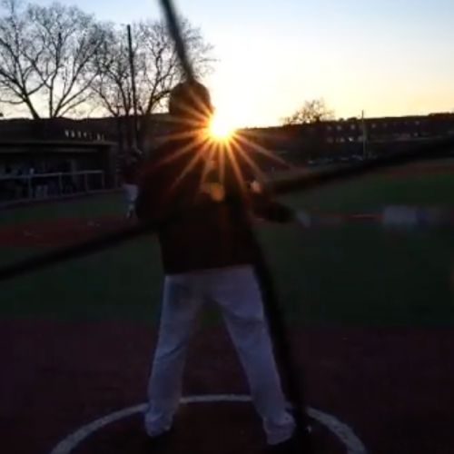 A baseball player in the sunset