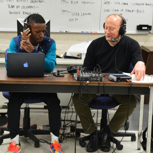 Student Kris Rhim and professor Marty Dobrow record a podcast