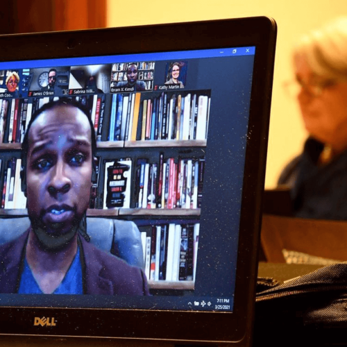 Author and antiracist activist Ibram X. Kendi with President Mary Beth Cooper in the background during his virtual presentation