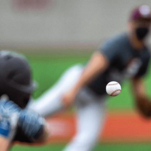 Focus on a pitched baseball during a Springfield College game