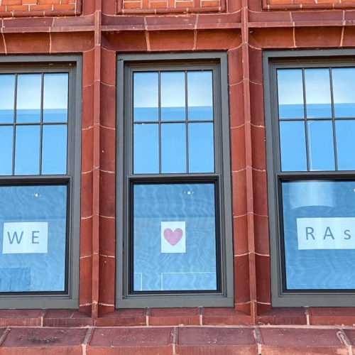 We Love Our RAs, a sign seen in the President's office windows.