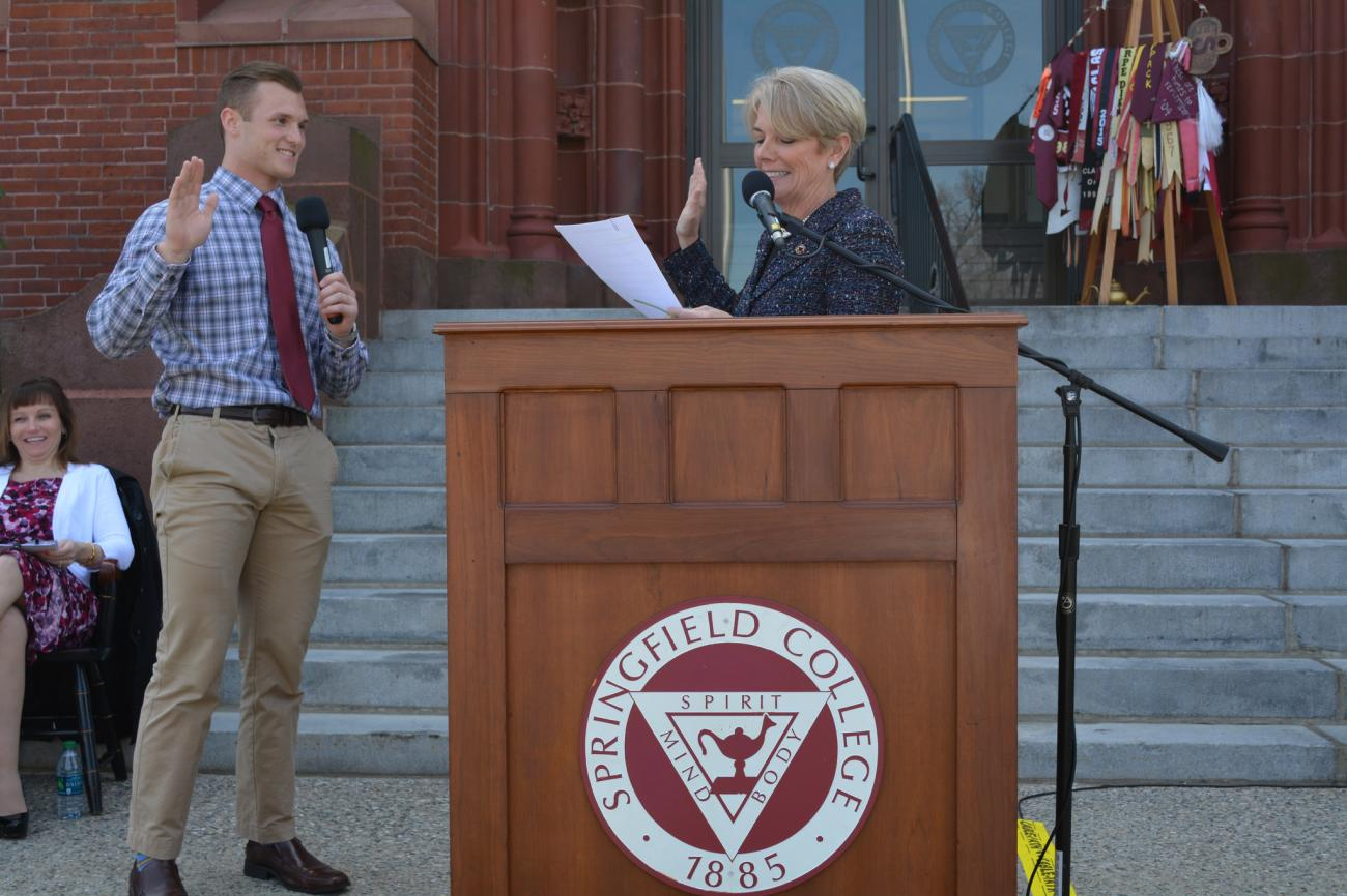 Student Trustee Troy Ward sworn in by President Mary-Beth Cooper.