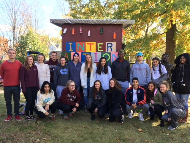 Springfield College art students in front of habitat they help build.