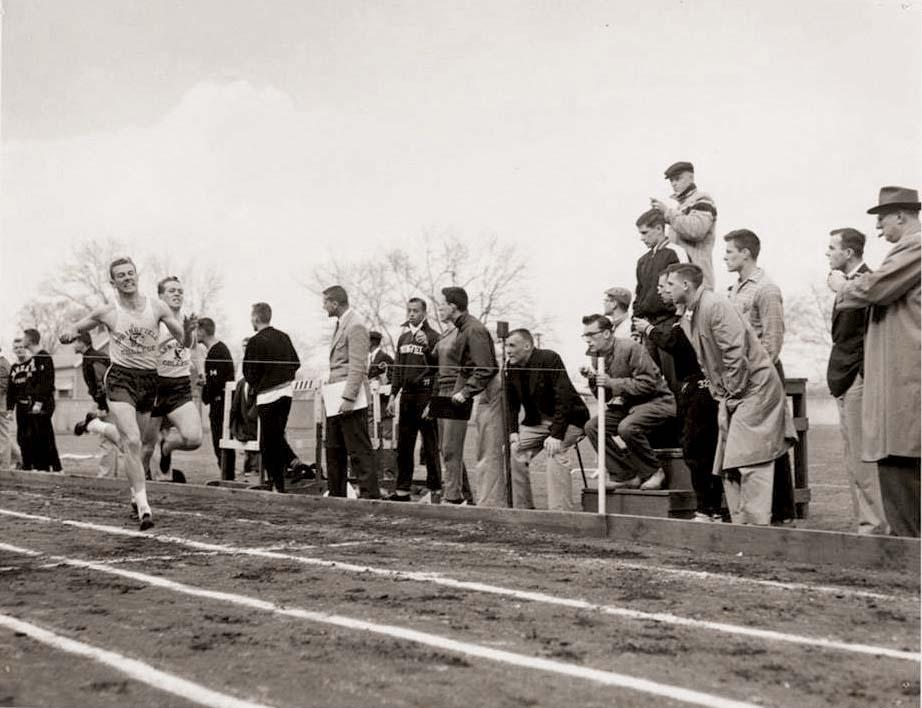 Jim White breaking the tape in the 440 vs. Amherst College in 1956