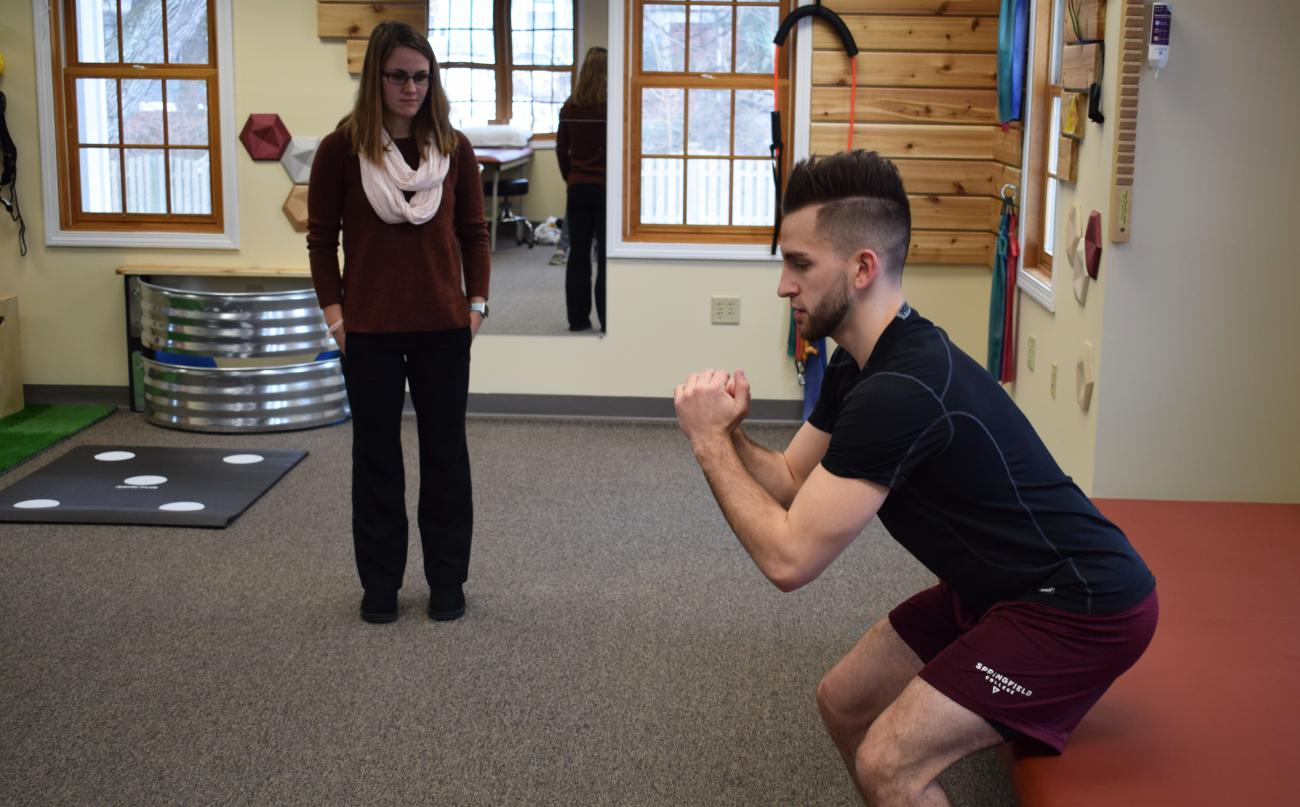 At left, Springfield College 2018 graduate of the physical therapy program Abby Mulligan works with a patient at the clinic on the campus.