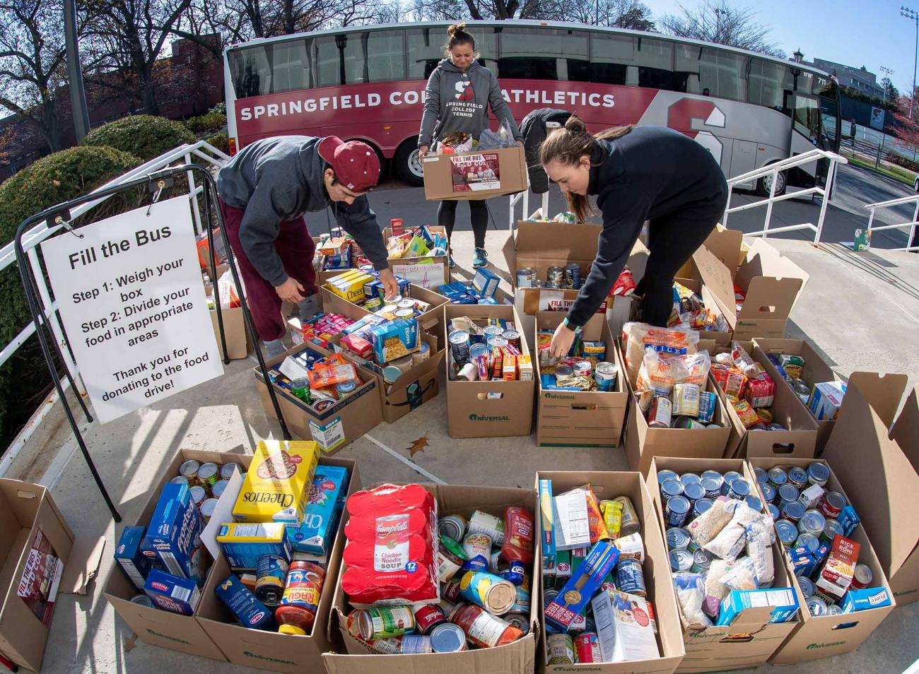 The Springfield College campus community filled the Springfield College Athletics bus on Thursday, Nov. 20, with more than 2,900 pounds of non-perishable food items as part of the annual Fill the Bus campaign, sponsored by the Springfield College Student Athlete Leadership Team (S.A.L.T.), the Department of Public Safety, and the Division of Inclusion and Community Engagement.
