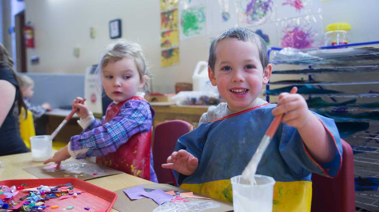 Happy kids doing crafts